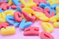 Beaucoup de lettres colorées de sucre Photographie stock libre de droits