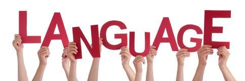 Beaucoup de mains de personnes tenant la langue du monde rouge Photos libres de droits