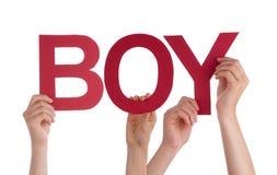 Beaucoup de mains de personnes tenant le garçon droit rouge de Word Photo libre de droits