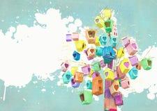 Beaucoup de maisons d'oiseau sur un arbre Concept de la Communauté Décor de volière Emboîtement-boîtes peintes Photos libres de droits