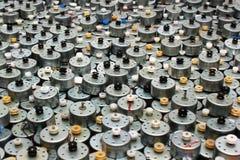 Beaucoup de petits moteurs électriques utilisés comme fond Photos libres de droits