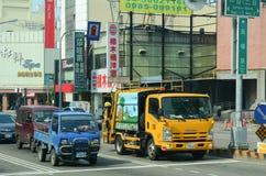 Beaucoup de véhicules sur la rue à Taichung Images stock
