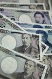 Beaucoup de Yens japonais, les factures de devise argent du Japon Images stock