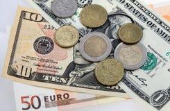 Beaucoup euro et dollars d'argent Image stock