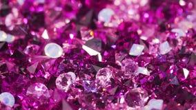 Beaucoup le bijou violet de diamant lapide le fond de luxe tournant banque de vidéos