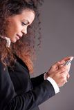 Beaufitul afro-american curly girl watching her mobile Royalty Free Stock Image