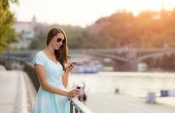 Beaufitul brunette young woman in city Royalty Free Stock Images