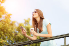 Beaufitul brunette young woman in city Royalty Free Stock Image