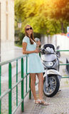Beaufitul brunette young woman in city Stock Photo