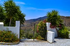 A beauiful gate and white stone wall in a scenic landscape in Spain. royalty free stock photography