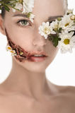 Beauiful girl with huge wound on cheek and flowers covering face Royalty Free Stock Photography