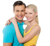 Beauitful attractive couple hugging. Attractive couple hugging with smiley faces, love concept Royalty Free Stock Image