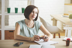 Beauitful business woman doing paperwork Royalty Free Stock Images