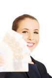 Beauitful woman holding some Euro currency Royalty Free Stock Photos