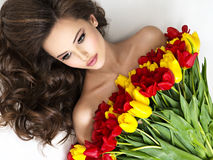 Beauitful young woman with bouquet of flowers. royalty free stock photos