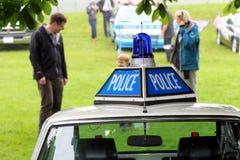 Beaulieu, Hampshire, R-U - 29 mai 2017 : Insignes et bleu de police Images libres de droits