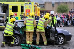 Beaulieu, Hampshire, UK - May 29 2017: Firemen preparing to remove the roof from a car during a vehicle rescue demonstration by t. He UK Emergency Services stock photography