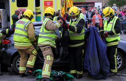 Beaulieu, Hampshire, UK - May 29 2017: Firemen removing a passenger door from a car during a vehicle rescue demonstration by. The UK Fire Brigade stock photos