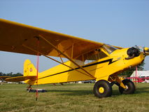 Beauliful classic Piper J3 Cub with oversized Alaska tires. Stock Photography