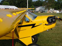 Beauliful restored antique Piper J3 Cub. The photo of this beauliful classic Piper J3 Cub with oversized Alaska tires was taken during the annual EAA Airventure Royalty Free Stock Photo