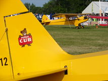 Beautiful restored classic Piper J3 Cub. The photo of this beautiful restored classic Piper J3 Cub was taken during the annual EAA Airventure fly-in convention Stock Photography