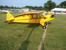 Beauliful restored classic Piper J3 Cub. The photo of this beauliful restored classic Piper J3 Cub was taken during the annual EAA Airventure fly-in convention Royalty Free Stock Photography