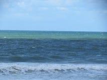 Brazilian Beach Sand , Waves, Ocean and Sky. A beautiful Picture in Brazilian Beach show Sand, landscape, waves foam, ocean and Blue Sky stock photo