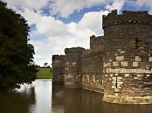 Beaumaris Castle. A moat surrounds the 13th Century Beaumaris Castle on Anglesey, Wales, UK Stock Photography