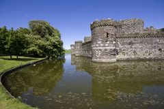 Beaumaris castle. A ruined fortress with its moat on the Ilse of Anglesey Stock Image