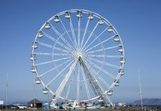 Beaumaris, Wales - the Ferris wheel and blue sky. This image shows the Ferris wheel against a blue sky in Beaumaris, Wales. It was taken on a bright, sunny day stock image
