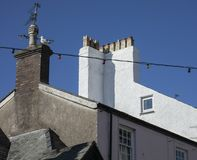 Beaumaris, Wales - house, chimney and a seagull. This image shows some houses in Beaumaris, Wales. It was taken on a bright, sunny day in May 2018. It was taken Stock Image
