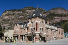 Beaumont Hotel on corner of Main Street with mountains in the background, Ouray, Colorado stock images