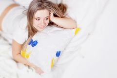 Beauriful girl in bed Stock Photos