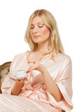 Beauriful girl in nightgown drinking coffee Stock Photography