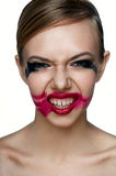 Beaury evil Girl with scary Smile. Smeared Mascara and Lipstick stock photo
