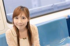 Beauté asiatique dans des chariots de MRT Photographie stock libre de droits