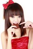Beauté chinoise mangeant le secteur photographie stock