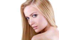 beauté Verticale d'une jeune femme sur le fond blanc Photographie stock