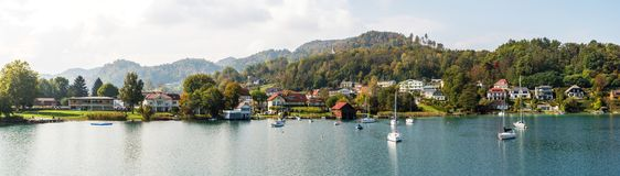 Beautiful autumn panoramic Wörthersee, Österreich. Small town and yachts on the shore. Austria. royalty free stock image