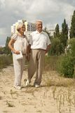 Beauteous elderly couple went for a walk. Charming elderly couple went for a walk on spring day Stock Images