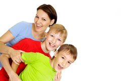 Beauteous family in bright T-shirts. Fun family in bright T-shirts on a white background Royalty Free Stock Photography