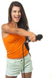 Beauteous lady is offering to join her singing. Young girl is holding the microphone on the white background. Beauteous lady is offering to join to her singing Stock Images