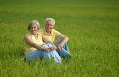 Beauteous old couple. In the middle of the field Stock Photo