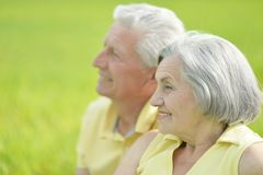 Beauteous old couple. In the middle of the field Stock Images
