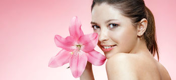 Beauteous young woman with flower Royalty Free Stock Images