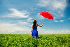 Girl with suitcase and umbrella at wheat field Stock Photos