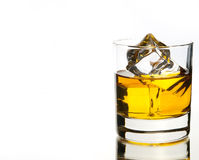 Beautful adiction. Whiskey on the rocks on white with reflection Royalty Free Stock Images