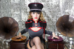 Beautful military disco dj with gramophones. Beautiful sexy disco dj in military uniform and hat with gramophones. Perfect for stylish club, disco and fashion Royalty Free Stock Photo