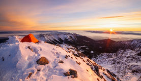 Beautful sunset on the top of Tatras mountains. Snow camping at Jahnaci stit, Tatras, Slovakia with a beautiful sunset Royalty Free Stock Images