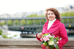 Beautful woman with flowers Stock Images